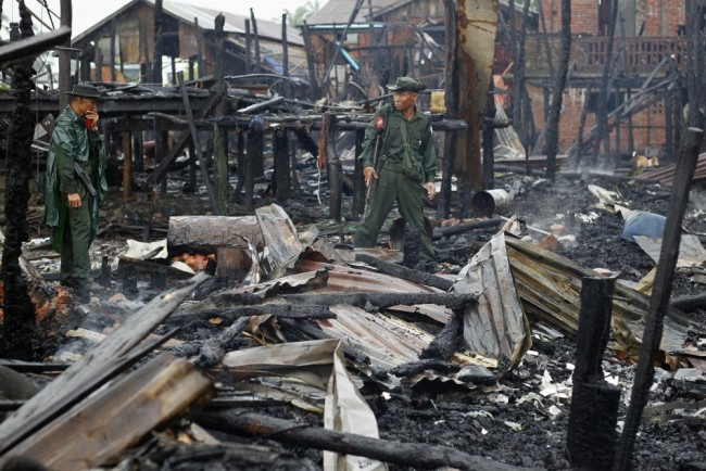 282610-soldiers-patrol-through-a-neighbourhood-burned-in-recent-violence-in-s-e1380758910232