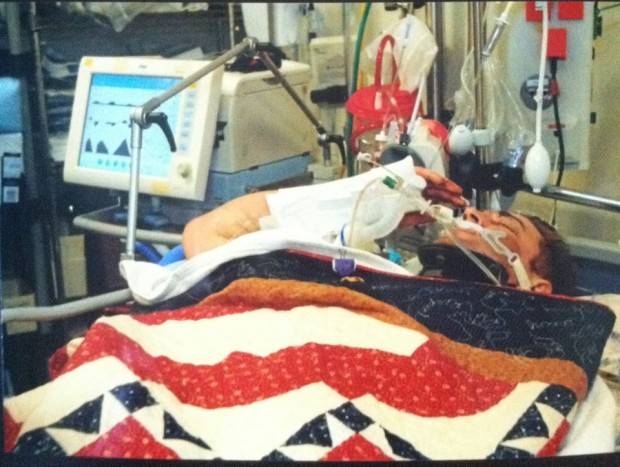 U.S. Army Ranger Josh Hargis, wounded at a base in Afghanistan, raises his hand in salute during his Purple Heart ceremony