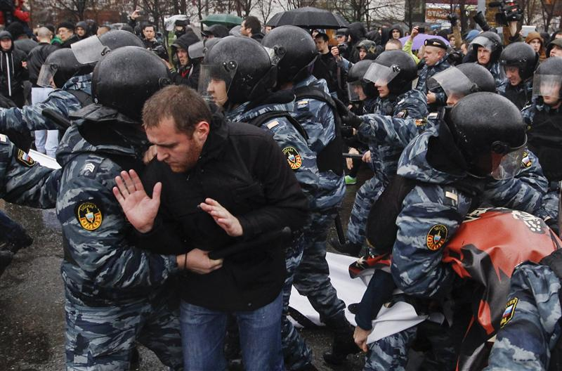"Riot police block participants during a ""Russian March"" demonstration on National Unity Day in Moscow"
