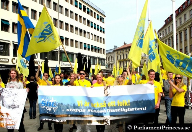 "SWEDEN Democrats (Youth Div) carry signs that say: ""We are also a people. Stop hostility towards Swedes."""