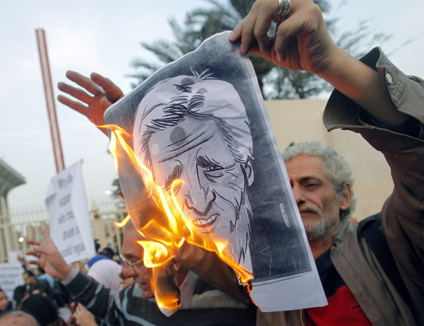 Egyptian activists burn a poster depicting U.S. Secretary of State John Kerry during a protest outside the Egyptian foreign ministry in Cairo, Egypt, March 2, 2013.