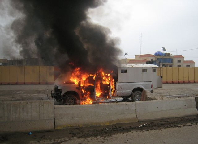 A police truck full of prisoners being transported was set afire by al Qaeda fighters after they freed prisoners in front of the main provincial government building, in Fallujah