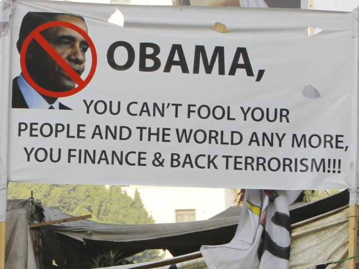 One of the many anti-Obama signs carried during the June 30th protests against Mohamed Morsi