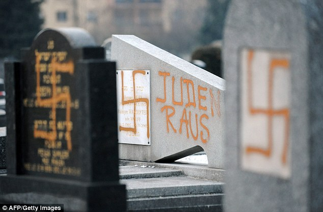 """'Jews out"" - Some of the 18 gravestones in the Cronenbourg cemetery in Strasbourg, France, that have been marked with swastikas and anti-Semitic slogans"