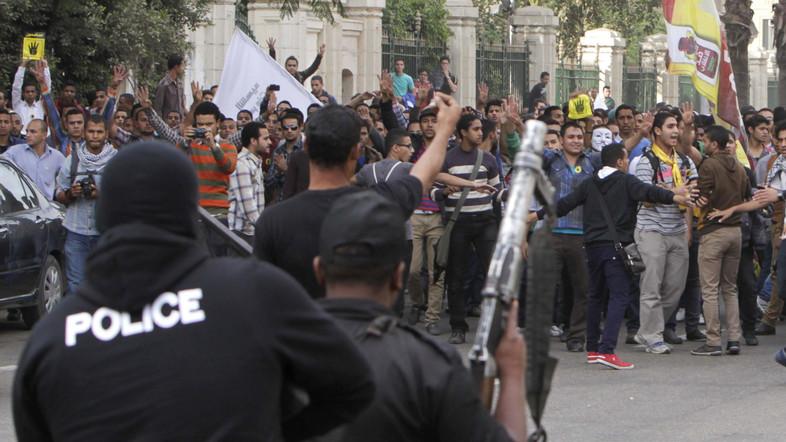 Egyptian police facing pro-Morsi protesters in Cairo in Nov. 2013
