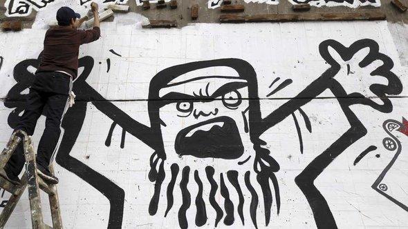 2-Karikatur-Muslimbr-der-am-Tahrirplatz-Reuters