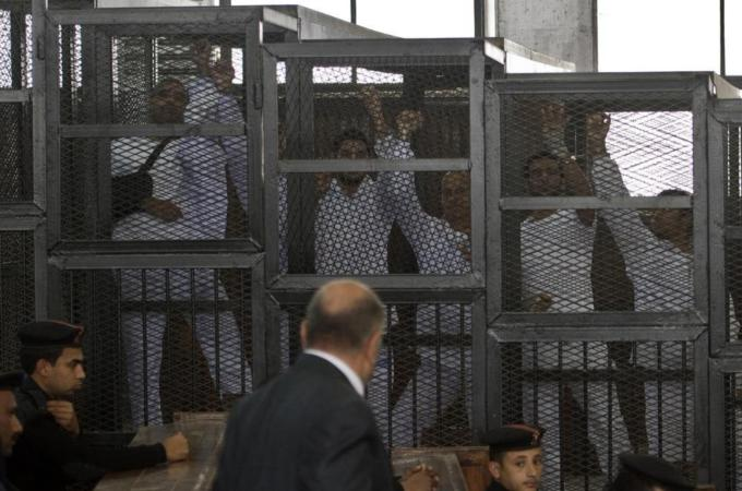 Awaiting execution, Morsi supporters caged like the animals they are
