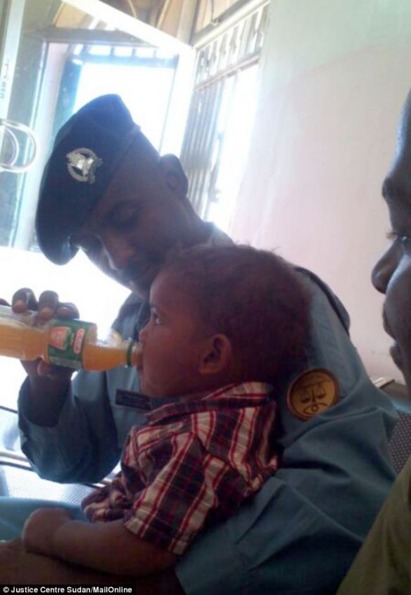 Martin is given a drink by prison guards. Daniel is not allowed to take custody of Martin because the authorities have ruled that the toddler is Muslim