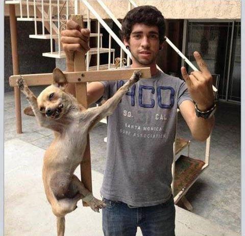 Muslim torturing a dog
