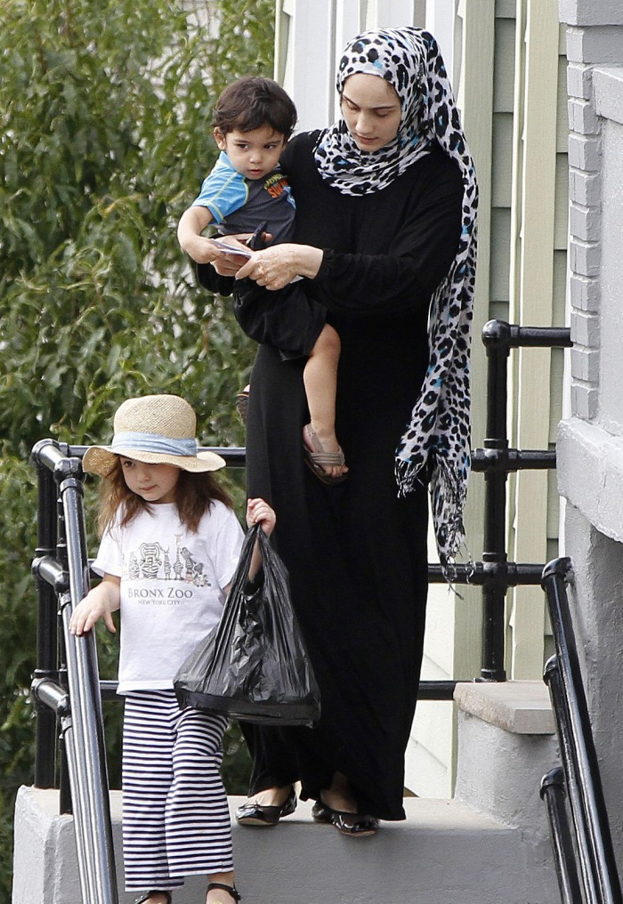 Ailina Tsarnaeva leaving her home with her little terrorists in training