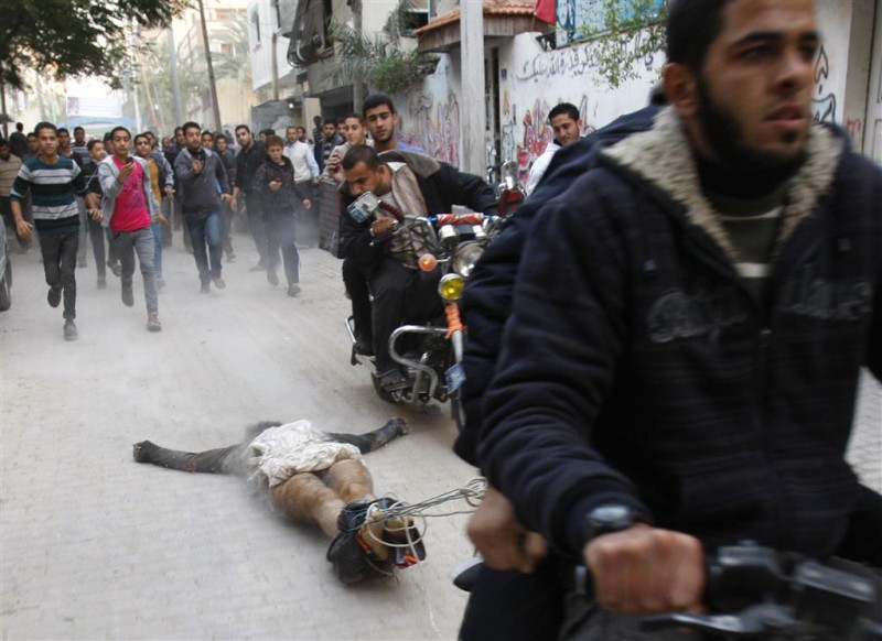 Dragging the bodies of alleged informers through the streets of Gaza