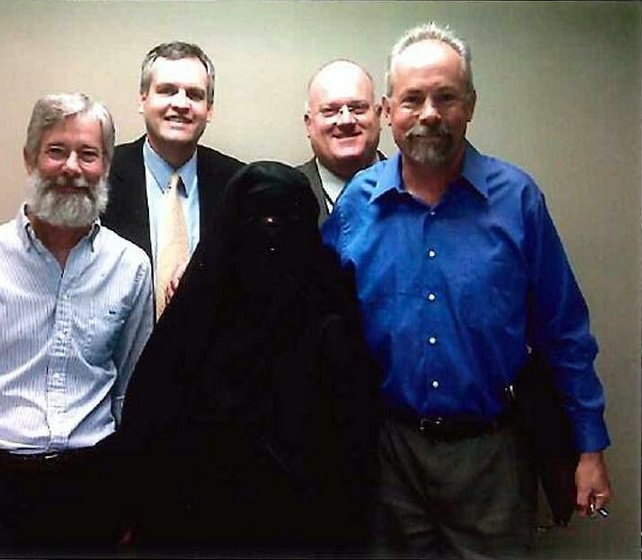 Engineering manager George Briest, human resources manager Thomas Wood, operations manager Tom Kennedy and retired operations supervisor Eric Phillips posed with Kim Thorner, in the office in November 2009.