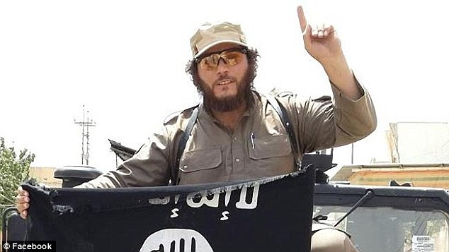 Khaled Sharrouf, the number one most wanted terrorist in Australia, pictured brandishing the Islamic State flag