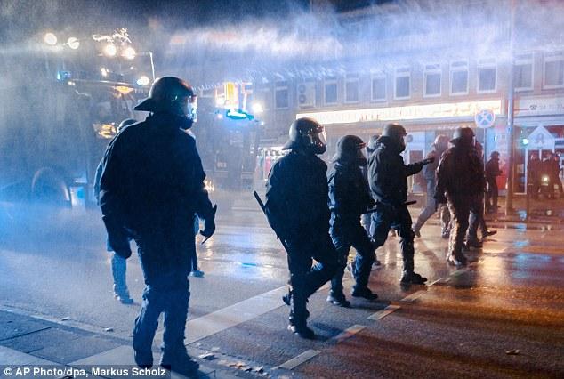 1412761698658_wps_4_Police_walk_through_the_m