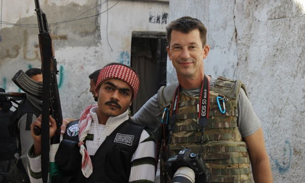 """John Cantlie with one of his Syrian """"rebel"""" pals before they were one of his captors"""