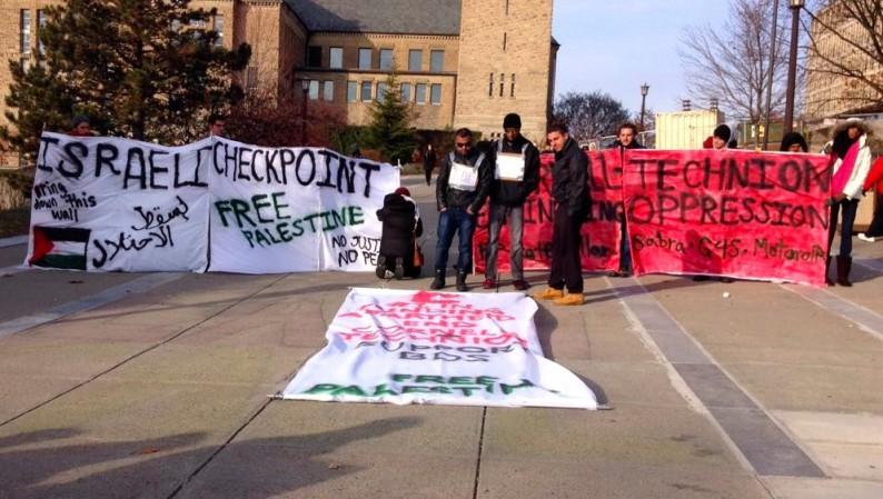 Cornell-SJP-Mock-Checkpoint-Ho-Plaza-11-19-2014-e1416598760469