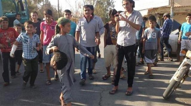 ISIS child carrying decapitated head