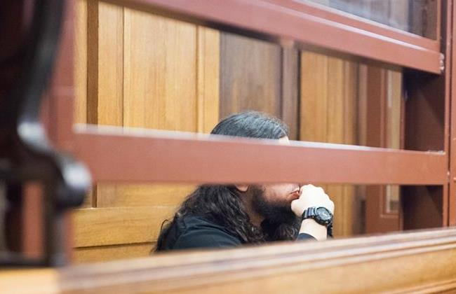 Fatih K, alleged member of the terrorist group Jund al-Sham operating in Syria, sits in the dock of the superior court of Justice in Berlin