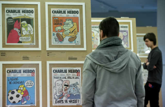 výstava titulních stránek satirického týdeníku Charlie Hebdo---exhibition presenting nearly 200 front pages of the French satirical magazine Charlie Hebdo
