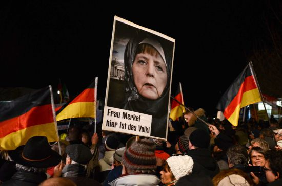 Chancellor Angela Merkel under fire for her mass Muslim immigration policies