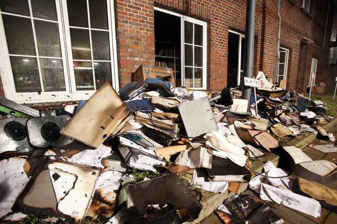 Burnt and damaged files are seen in the courtyard of German regional newspaper Hamburger Morgenpost editorial office