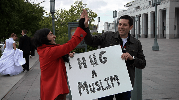 Obeidallah (right) making a fool out of himself on a NYC street
