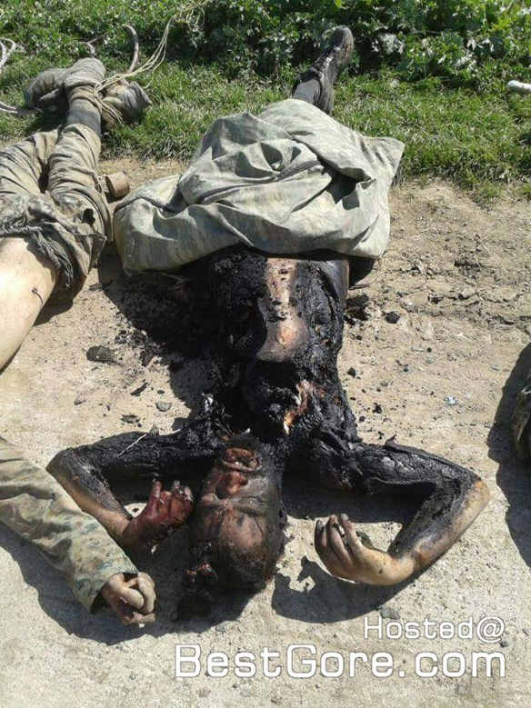 isis-fighters-killed-kurdish-ypg-soldiers-dragged-around-04