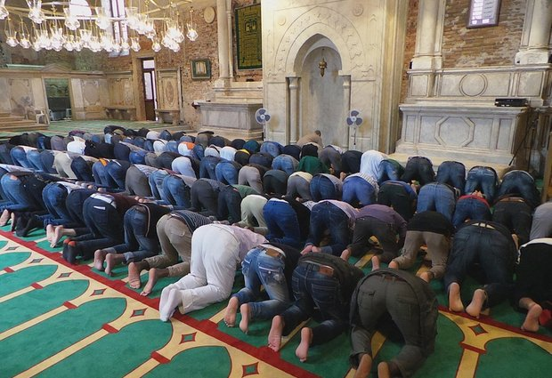 Muslims pray inside the former Misericordia Abbey in Venice, Italy. Venice officials have ordered the closure of a working mosque set up as Iceland's exhibit for the 56th Venice Biennale contemporary art fair in what was once a Catholic church.