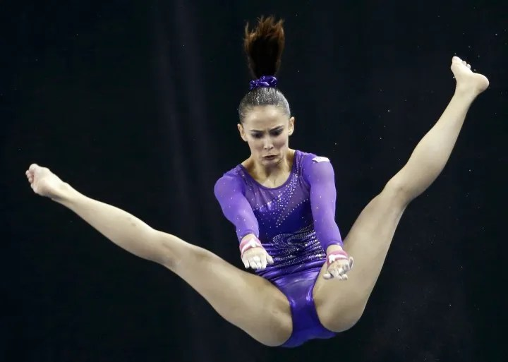 Malaysia's Farah Ann Abdul Hadi performs on the uneven bars during the women's artistic gymnastics team final at the Southeast Asian (SEA) Games in Singapore June 7, 2015.
