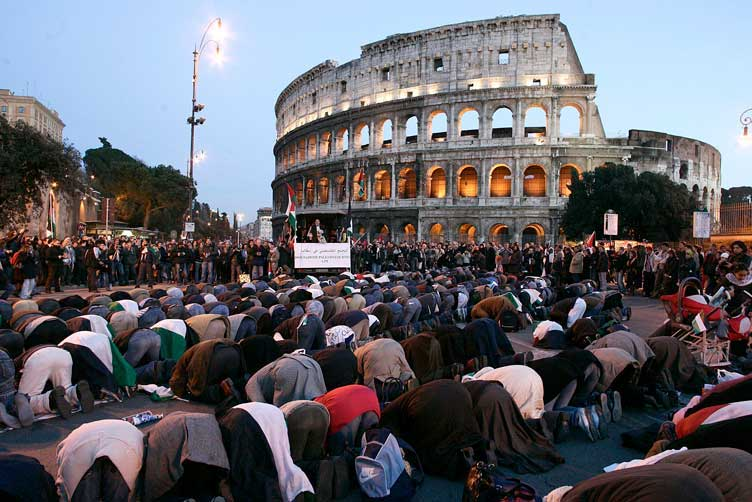 Muslims lift their asses to Allah in front of the Colosseum in Rome