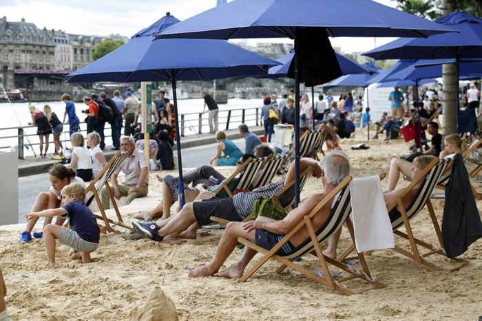 "People relax on deckchairs as ""Paris Plages"" opens along the banks of River Seine in Paris"
