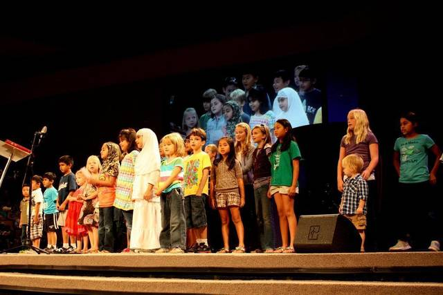Christian and Muslim children sing together at a special service at NorthWood Church in Keller in 2011, a gathering that was attended by 2,500 people, including more than 1,000 Muslims from across the Metroplex