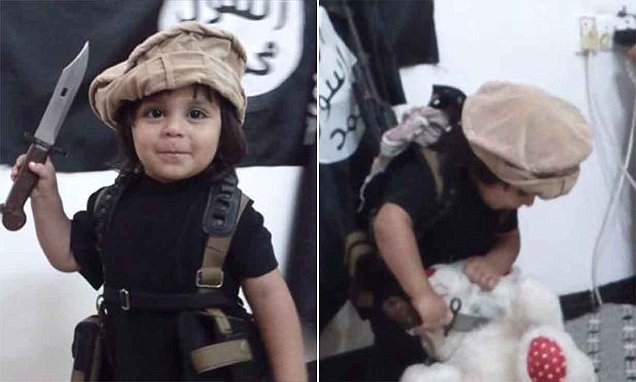 Terror toddler filmed sawing off teddy bear's head with ISIS backdrop