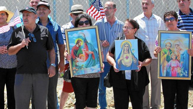Iraqi Chaldean Christians rally in support of 27 Chaldeans being held at an ICE detention center in California.