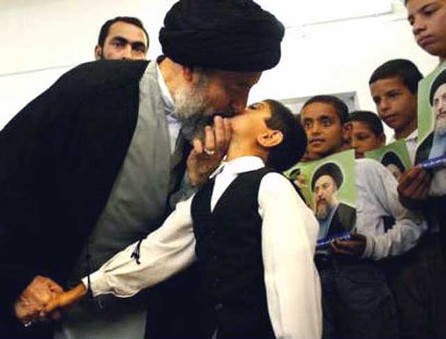 muhammad-baqir-al-hakim-kisses-boy-on-lips-on-arrival-to-supreme-council-najaf-iraq