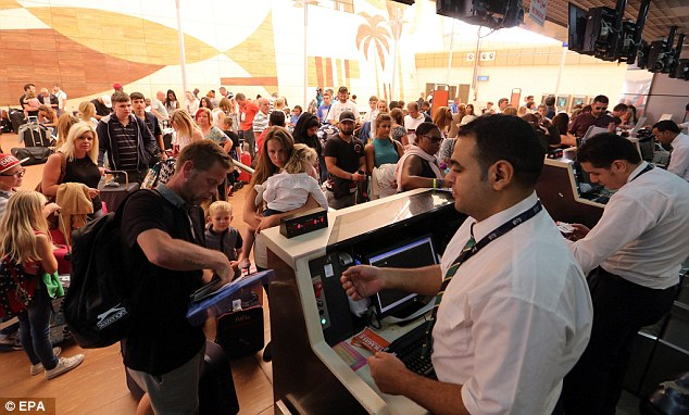 Stranded tourists gather at airport check-in counters trying to get out of Sharm el-Sheikh