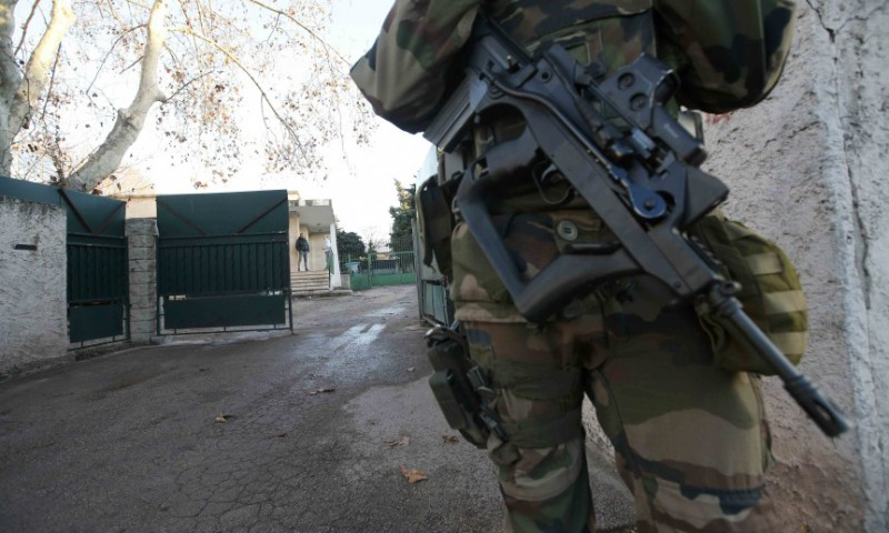 An armed French soldier secures the access to a Jewish school in Marseille 9th district
