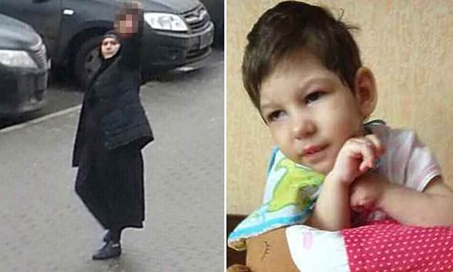 38-year-old Gyulchekhra Bobokulova, holding the severed head of the child