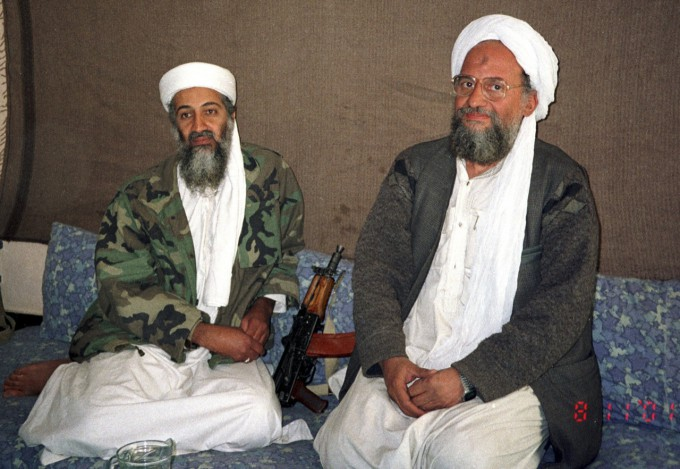 Osama bin Laden (L) sits with his adviser and successor Ayman al-Zawahiri