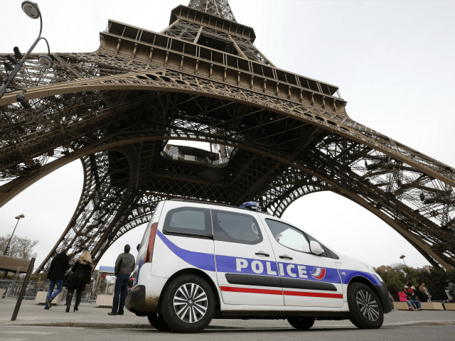 Police-car-stationed-next-to-the-Eiffel-Tower-in-Paris-Getty-640x480