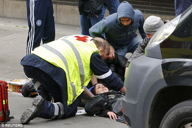 32C6898F00000578-3520777-Although_seriously_injured_the_woman_appeared_to_be_conscious_to-a-49_1459630533406