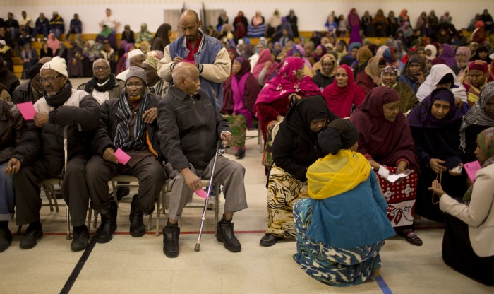 In a local community center, Somali Muslim men on one side, women on the other per sharia law