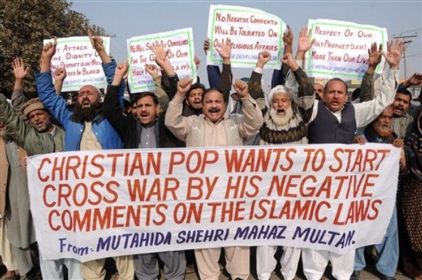 Pakistani protestors hold banners and chant slogans against recent statements by Pope Benedict XVI about Pakistan's blasphemy laws,