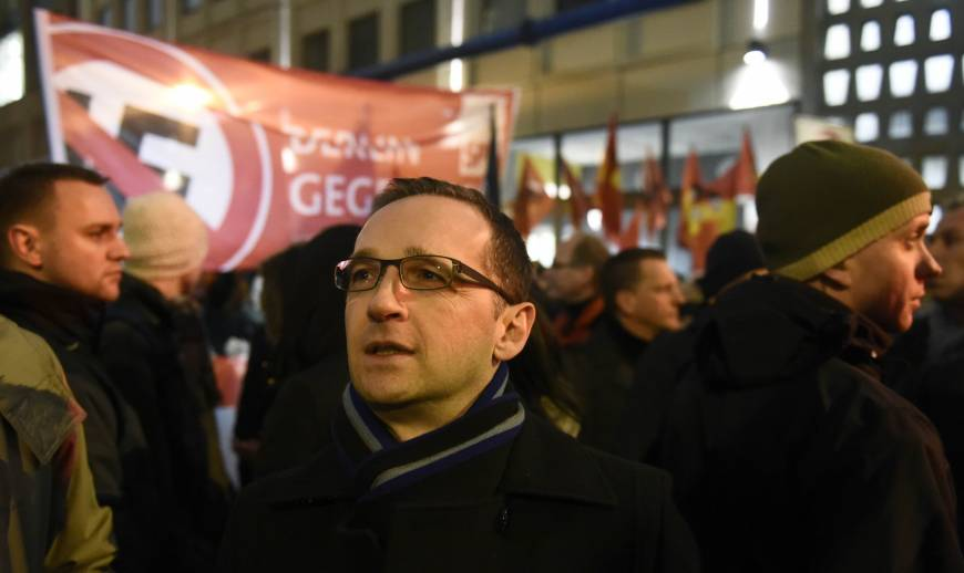 German Justice Minister Heiko Maas (center) takes part in a demonstration against a PEGIDA rally which calls for an end to massive Muslim migration