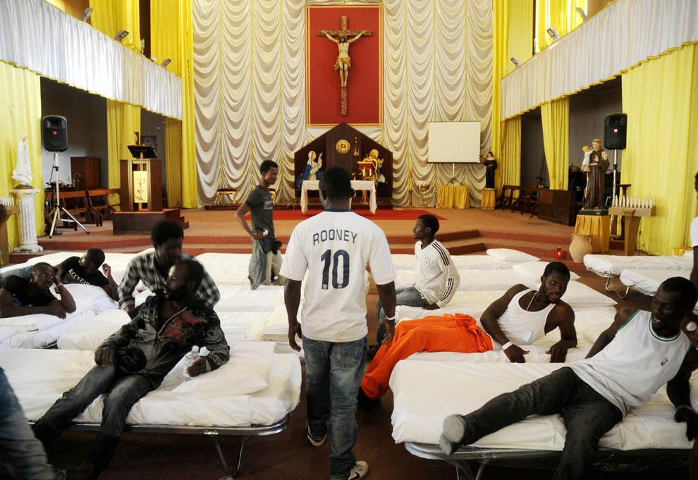 Migrants in a church