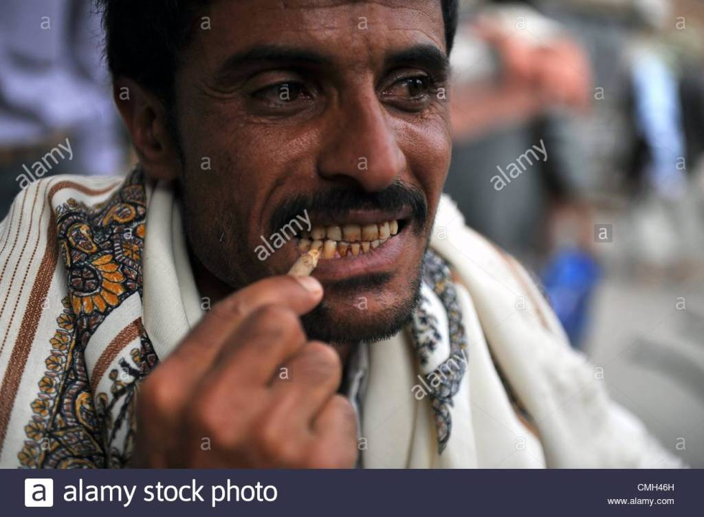 epa03345739-a-yemeni-man-uses-a-miswak-a-teeth-cleaning-twig-which-CMH46H