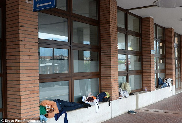 Families have moved in at the San Giovanni Station (pictured), as they wait to find a way how to cross into neighbouring Switzerland