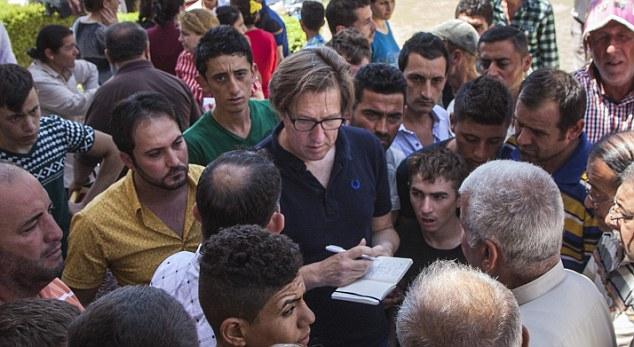 refugiados cristianos viven con el temor de los refugiados musulmanes reunidos en los mismos centros