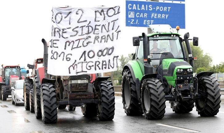 Farmers join harbor workers, truck drivers, storekeepers and residents to attend a protest demonstration on the A16 motorway against the migrant situation in Calais