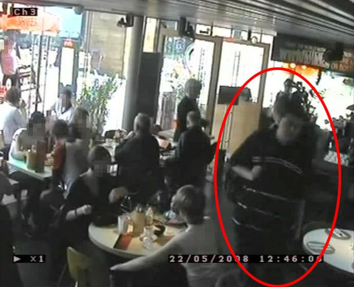 Reilly seen on camera carrying the explosives inside the restaurant